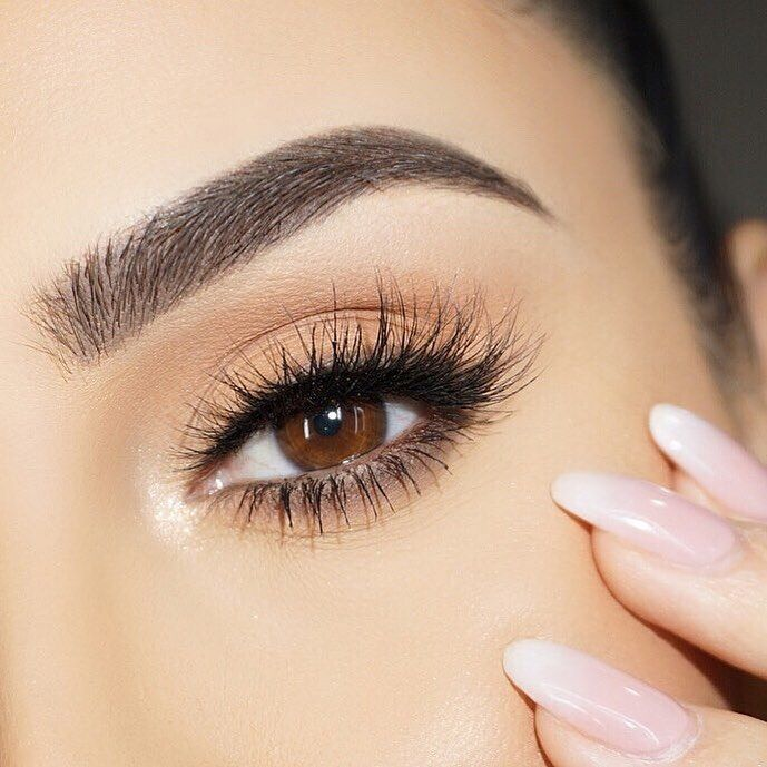 close up of lash extensions and brows